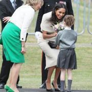 Впервые без мужа Меган Маркл сопроводила королеву Елизавету II на официальном мероприятии